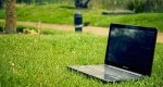 Laptop laid on grass